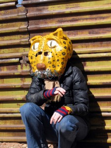 Person Wearing Jaguar Mask at the Wall  Photo by Tom Leskiw