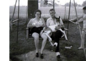 Mom and Dad in our porch swing, holding our foal, Frisky.